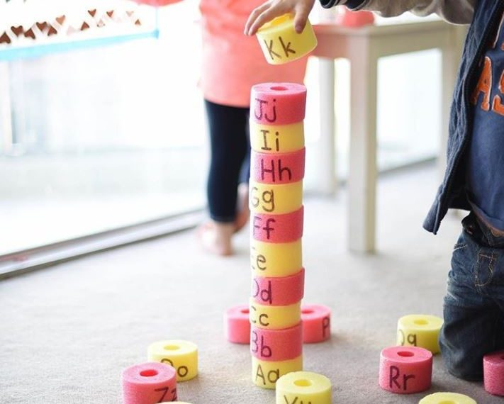Write letters of the alphabet on pool noodles then... | 101 Indoor Toddler Activities